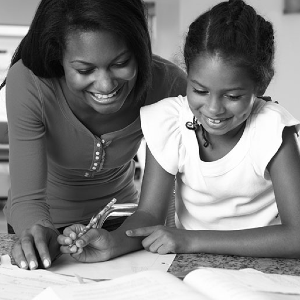 mother and daughter doing homework together.
