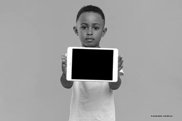 child holding tablet